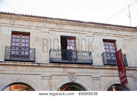 Police woman in the balcony
