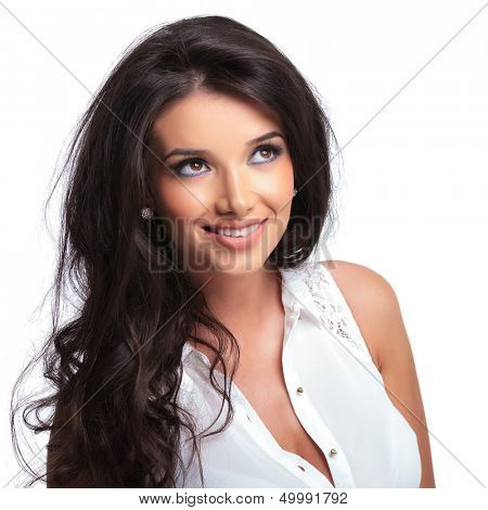closeup of a young beautiful woman looking up and smiling. isolated on a white background