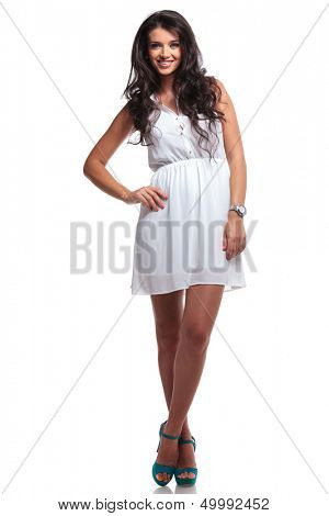 full length picture of a young beautiful woman standing with her hand on her hip and smiling for the camera. isolated on a white background