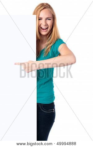 Excited Woman Pointing To A Blank Sign