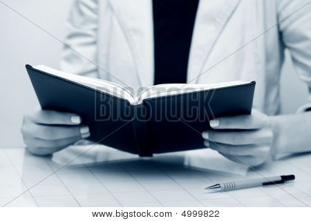 Businesswoman Reading.