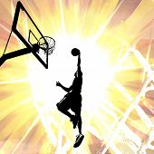 pic of slam  - Silhouette illustration of an athlete slam dunking a basketball over a fiery background - JPG