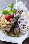 foto of greeks  - greek style pita bread with meat skewers  - JPG