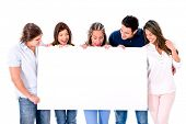 image of latin people  - Casual group of people holding a banner  - JPG