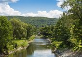 pic of woodstock  - This image was taken in the small town of Woodstock showing a tranquil river wandering through the Vermont greenery - JPG