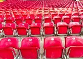 stock photo of grandstand  - Red and Empty Seats in a Grandstand - JPG