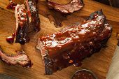 stock photo of roasted pork  - Smoked Barbecue Pork Spare Ribs with Sauce - JPG