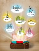 Tourist suitcase with famous landmarks around the world on grungy background poster