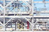 stock photo of lng  - Assembling of liquefied natural gas Refinery Factory with LNG storage tank using for Oil and gas industry background - JPG
