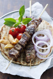 stock photo of souvlaki  - greek style pita bread with meat skewers  - JPG
