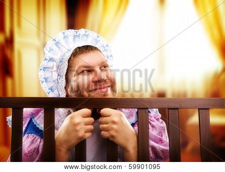 Funny man in playpen looking out