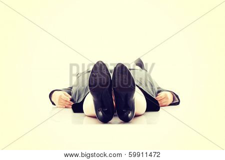 Businesswoman lying on the flor, isolated on white background