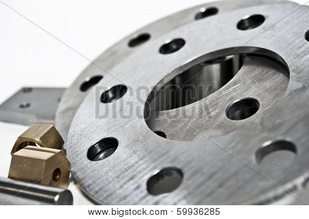 Metal Flanges And Brass Nuts. Milling Industry. Close-up.