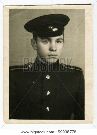 KURSK, USSR - CIRCA 1952: An antique photo shows studio portrait of a   cadet in uniform.