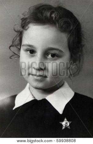 VILNIUS, LITHUANIA, USSR - CIRCA 1969:  An antique photo shows  portrait of a beautiful schoolgirl.