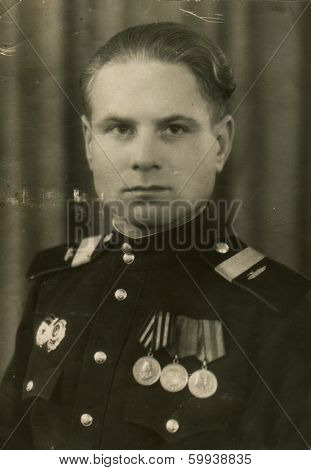 AUSTRIA - CIRCA 1945: An antique photo shows studio portrait of a Red Army staff sergeant, tank mechanic.