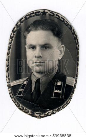 CEGLED, HUNGARY - CIRCA 1950: An antique photo shows studio portrait of a Soviet Army lieutenant, tank mechanic.