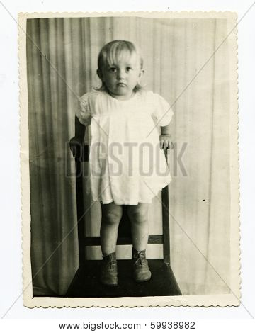 KURSK, USSR - CIRCA 1956:  An antique photo shows studio  portrait of a baby girl.