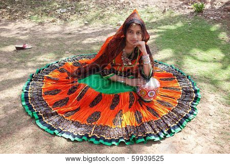 JAIPUR, INDIA - MARCH 29, 2012: girl with indian traditional costume in the celebration of the Gangaur festival, one of the most important of the year