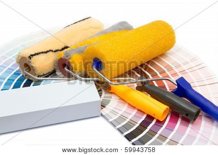 Three Painting Rollers And Album Of Colors