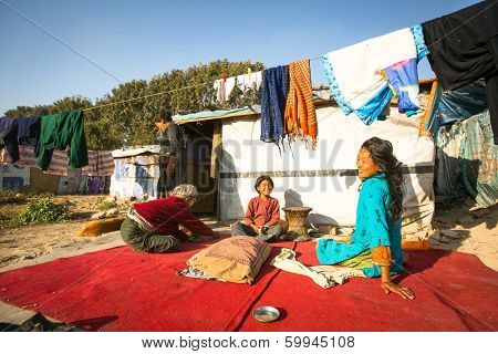 KATHMANDU, NEPAL - DEC 16, 2013: Unidentified poor people near their houses at slums in Tripureshwor district, Kathmandu. Caste of untouchables in Nepal, is about 7 % of population.