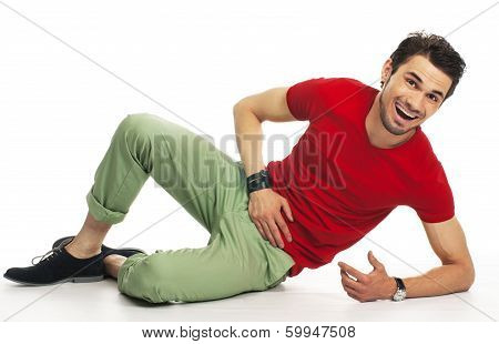 Teenager Lying On The Floor, Relaxing And Laughing