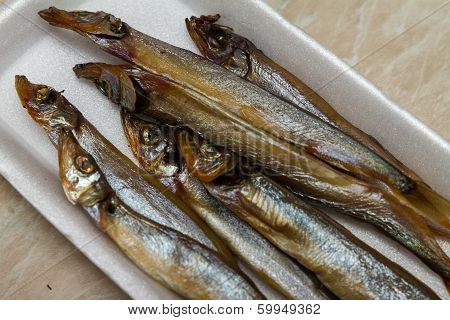 Smoked capelin on a substrate