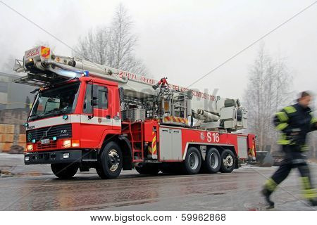 Rushed Fireman And Volvo FL12 Fire Engine Arriving At Fire Scene