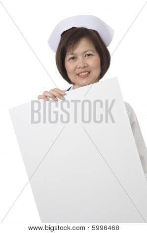 Friendly And Smiling Nurse Holding Sign