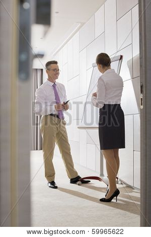 Business people preparing for presentation in office