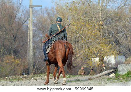 KIEV, UKRAINE -NOV 3: An unidentified member of Red Star history club wea historical German uniform during historical reenactment of WWII, Dnepr river crossing 1943, November 3, 2013. Kiev, Ukraine