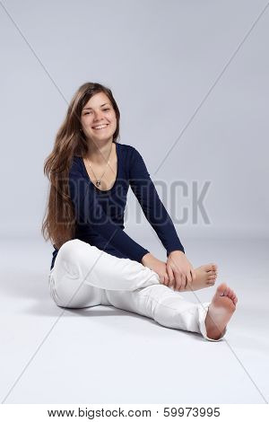 Young Long-haired Woman With Natural Beauty