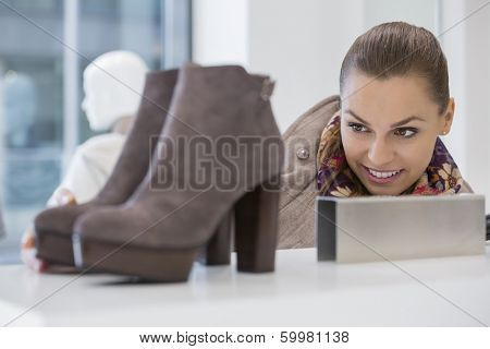 Woman admiring footwear in store