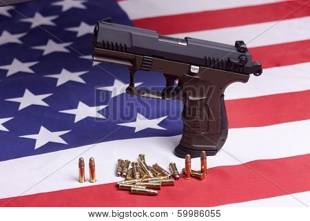 Close Up Of Pistol On Flag.