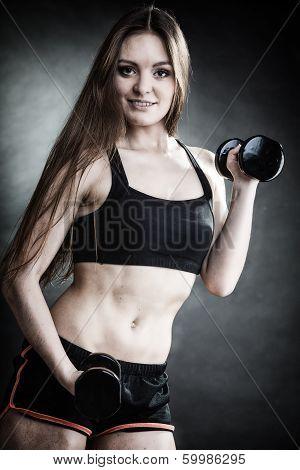 Fitness Girl Training Shoulder Muscles Lifting Dumbbells