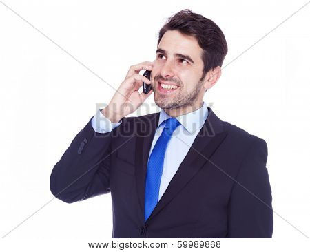 Handsome business man talking on the phone, isolated on a white background