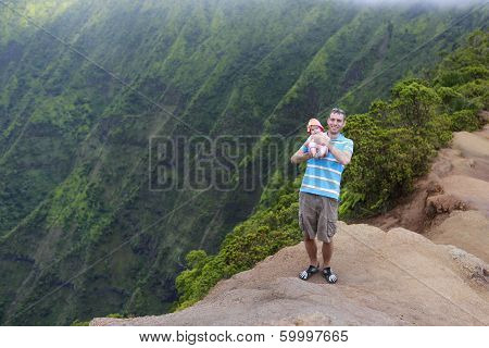 Father And His Baby In Kauai, Hawaiian Islands