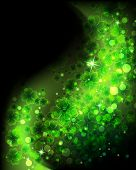 image of clover  - Wave of magic sparkling clover on a black background - JPG