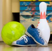 Bowling ball, pin and shoes