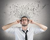 stock photo of confuse  - Concept of stress and confusion of a businessman - JPG