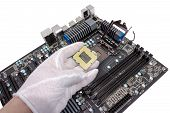 stock photo of electric socket  - Installation of modern processor in CPU socket on the motherboard - JPG