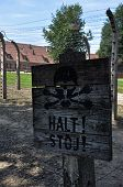 stock photo of auschwitz  - Sign of the danger zone in Auschwitz - JPG