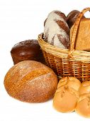 picture of bread rolls  - Composition with bread and rolls in wicker basket isolated on white - JPG