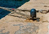 image of bollard  - Bollard and ropes for mooring at a quay on the island Malta.