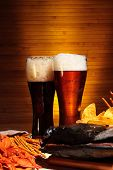 picture of crawdads  - Two glasses of dark and light beer with crawfish - JPG