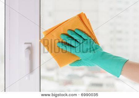 Hand In A Green Glove