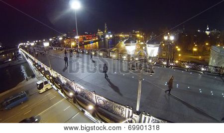 Patriarchal pedestrian bridge in Moscow at night, aerial view