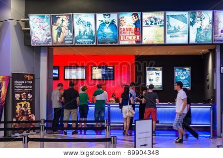 People Buying Tickets At The Cinema