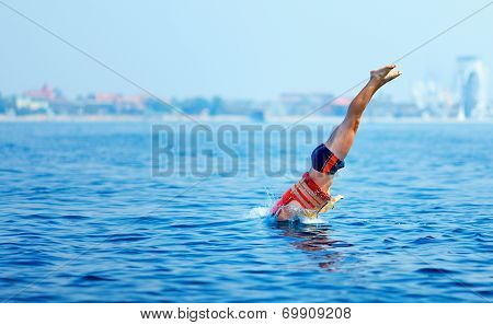 Man In Rescue Jacket Jumping In Water