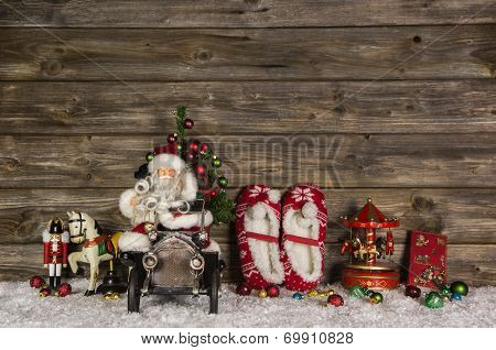 Nostalgic Wooden Christmas Decoration With Old Children Toys On The Background.